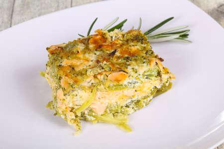 Tasty casserole with salmon and broccoli served rosemary Reklamní fotografie