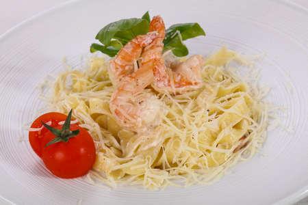 Italian pasta Linguini with prawns served basil Reklamní fotografie