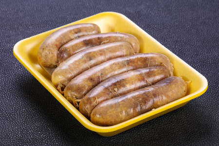 Raw chicken sausages ready for grill Фото со стока