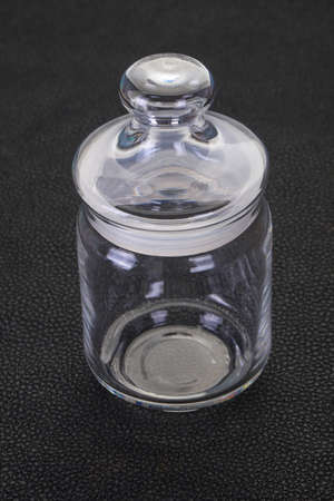 Empty glass can over wooden backgound Stockfoto