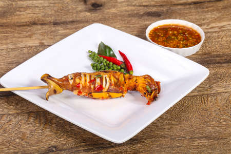 Grilled squid skewer with sauce and hebs Stockfoto