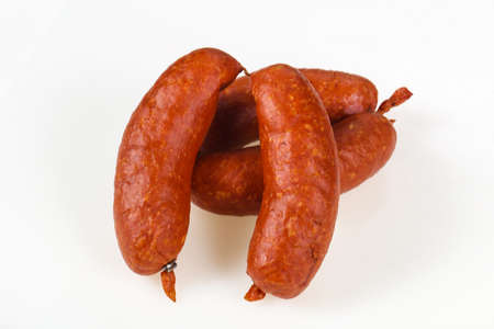 Tasty meat sausages ready for eat over white background Stock Photo