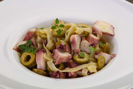 Pasta with octopus and olives Stock Photo