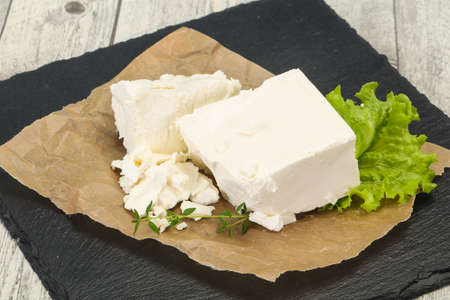 Greek traditional Feta soft cheese in the plate Фото со стока