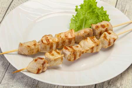 Grilled pork skewer served salad leaves
