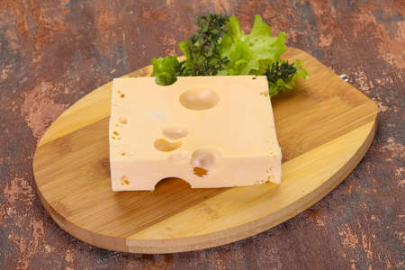 Maasdam cheese brick with thyme branch 写真素材