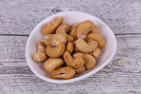 Tasty Cashew nuts heap in the bowl