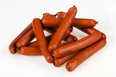 Tasty meat sausages ready for eat over white background Banco de Imagens