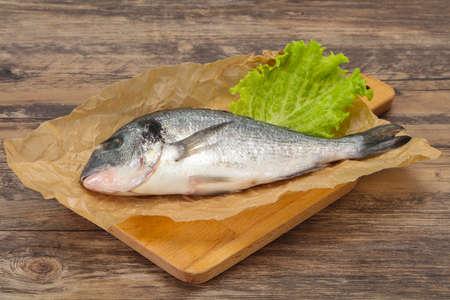 Raw Dorada fish ready for cooking Banco de Imagens - 133133263