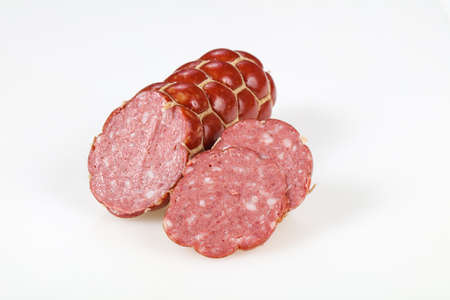 Tasty meat sausages ready for eat over white background Banco de Imagens - 133133462