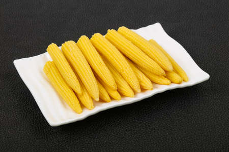 Pickled baby corn in the bowl Imagens