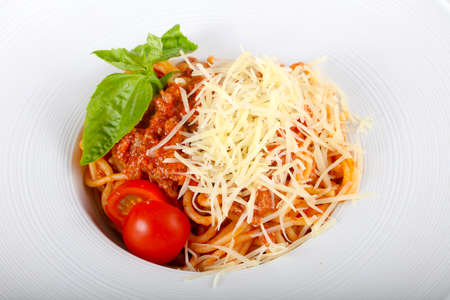 Bolognese pasta with basil leaves
