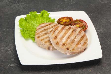 Grilled tuna steak with kumato and salad Stock Photo