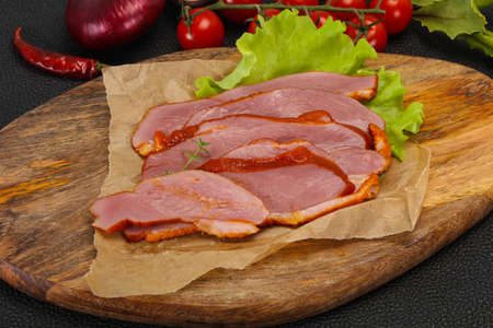 Sliced smoked duck breast served salad leaf Standard-Bild - 134979616