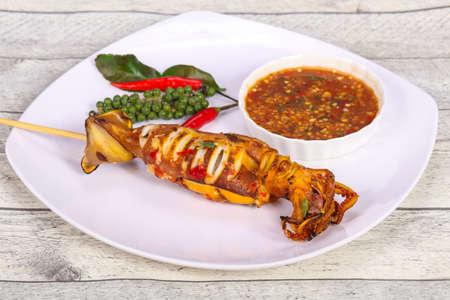Grilled squid skewer with sauce and hebs Reklamní fotografie
