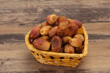 Sweet tasty dry dates dessert  in the basket