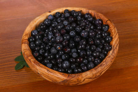 Wild blueberry in the wooden bowl