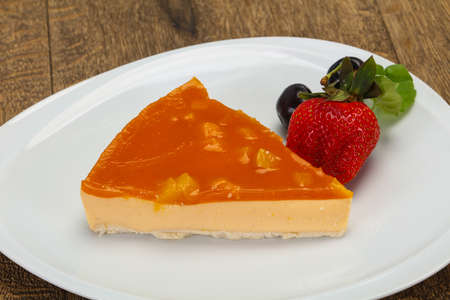 Cheesecake with apricot served strawberry and mint Stock Photo