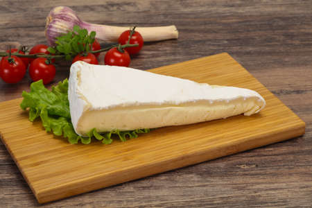 Brie cheese triangle served salad leaves Stock fotó