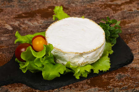 Delicous camembert cheese with salad leaves Stock fotó - 136469818