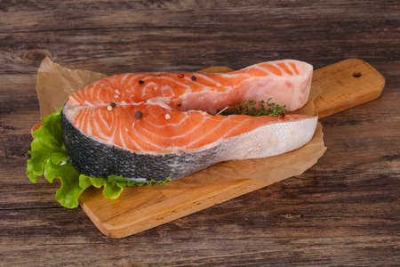 Raw salmon steak with salt and pepper - ready for grill Reklamní fotografie