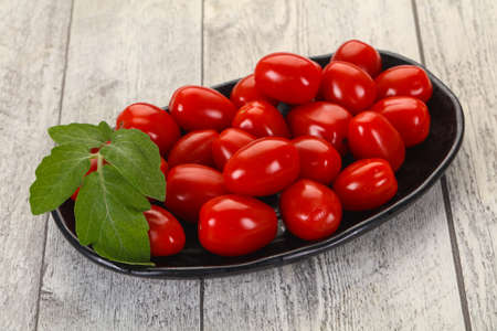 Sweet Red cherry tomatoes in the bowl 写真素材
