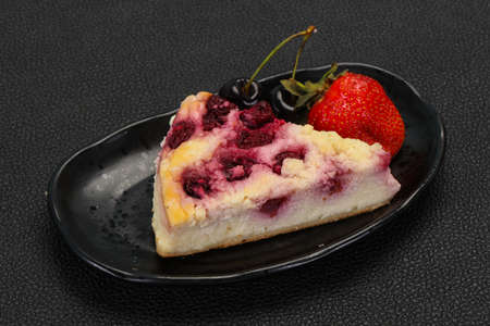 Cheesecake with cherry served strawberry and mint Stockfoto