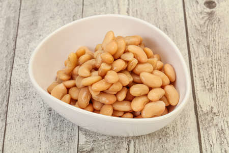 Vegan cuisine White beans kidney in the bowl Archivio Fotografico