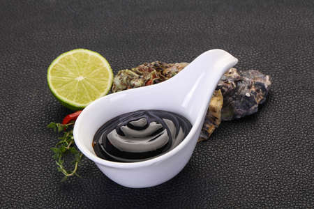 Traditional Oyster sauce in the bowl Фото со стока