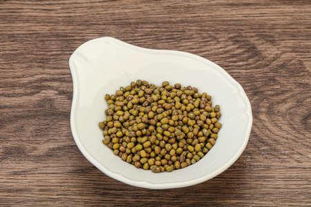 Vegetarian cuisine - dry green lentil for cooking Stok Fotoğraf - 147589164