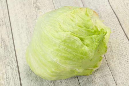 Fresh ripe green Iceberg salad - ready for cooking Imagens