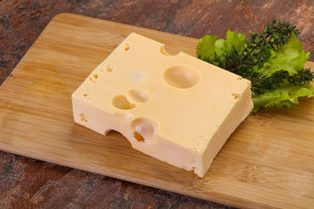 Maasdam cheese brick with thyme branch Zdjęcie Seryjne
