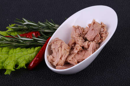 Tasty canned tuna fish in the bowl served salad leaves