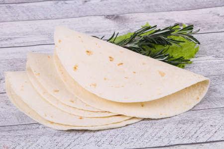 Empty homamade tortilla served salad leaves Zdjęcie Seryjne