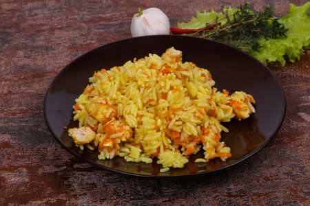 Traditional Pilaf with chicken and carrot served garlic and thyme Zdjęcie Seryjne