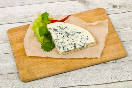 Blue cheese slice with salad leaves