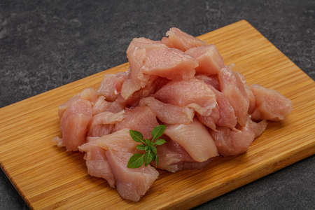 Raw diced chicken breast for cooking