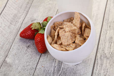 Wheat flakes for breakfast with milk and strawberry