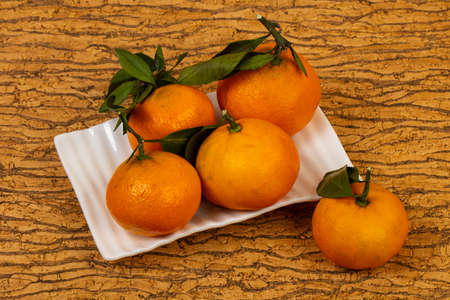 Sweet ripe Mandarin with green leaves