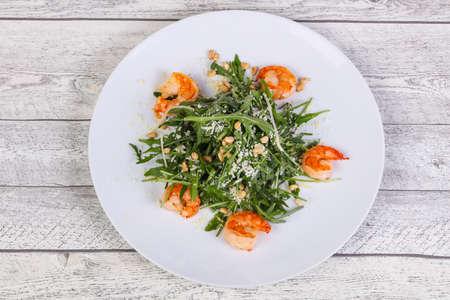 Rocket salad with prawn, parmesan cheese and cedar nuts