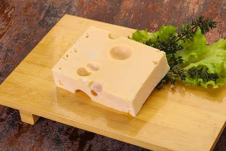 Maasdam cheese brick with thyme branch Reklamní fotografie