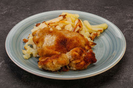 Homemade Pork schnitzel with roasted potato