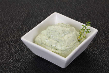 Cottage cream snack with herbs and garlic