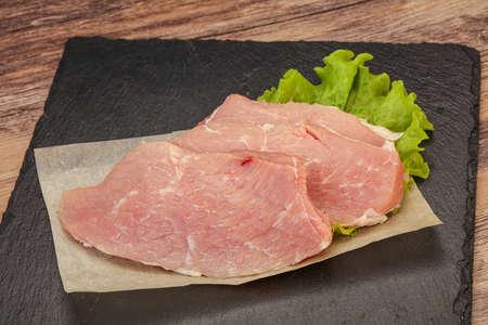 Raw pork steak ready for cooking Фото со стока