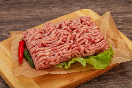 Raw Minced pork meat for cooking in the board