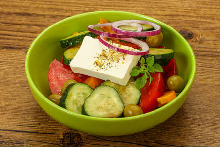 Traditional Greek salad with feta cheese and vegetables