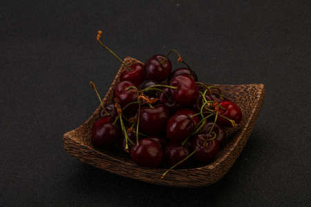 Sweet ripe bird cherry in the basket
