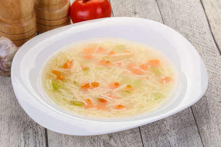 Chicken soup with noodles, carrot and celery