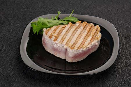 Grilled tuna steak served rocket salad