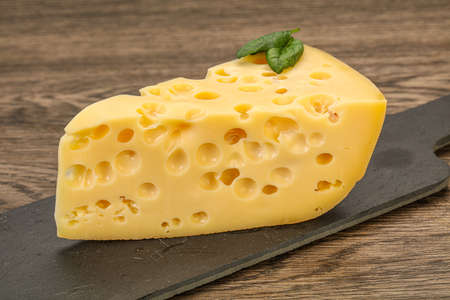 Maasdam cheese - dairy yellow triangle with holes